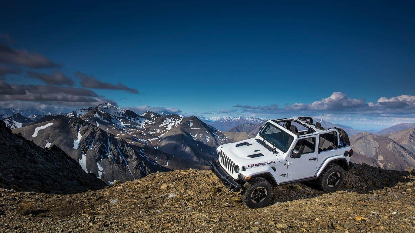 White Jeep Wrangler JL on a mountain