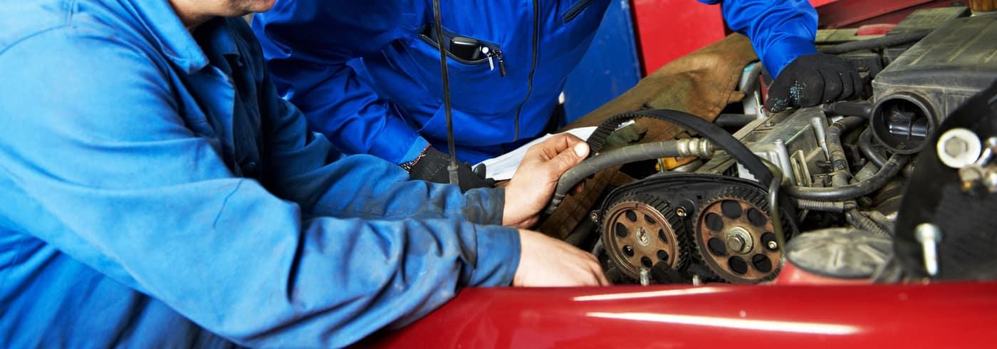 mechanic checking timing belt