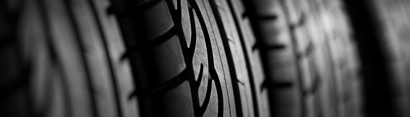 A close-up view of four tires in a row