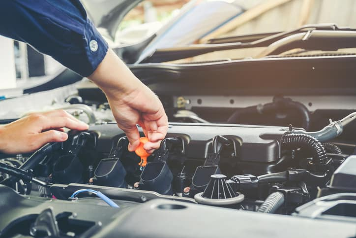 Mechanic Changing Car's Oil - Enfield, CT - Artioli Chrysler Dodge Ram