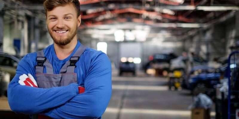 Mechanic smiling in service center