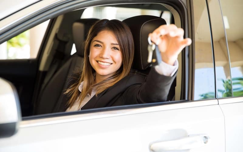 Woman holding her new car keys