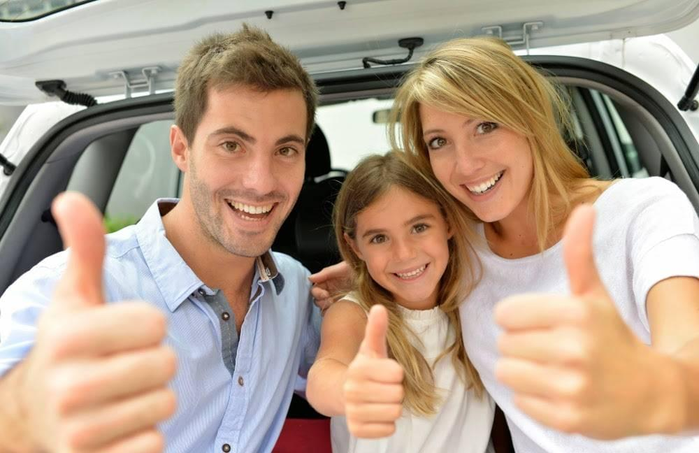 Cheerful smiling family showing thumbs up