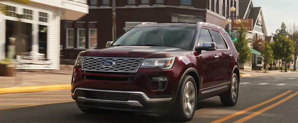Ford Explorer SUV driving in town