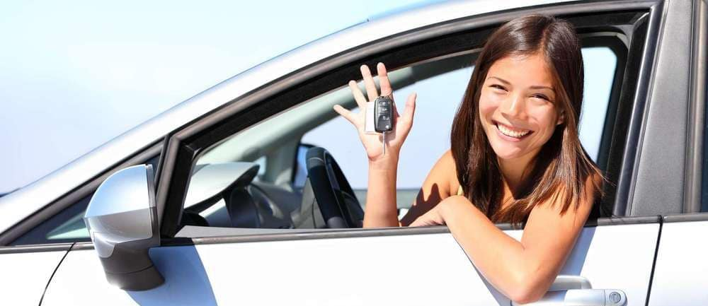 woman holding mazda key fob