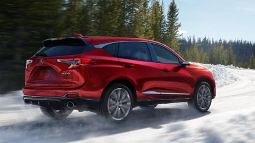 2019 Acura RDX driving through snow