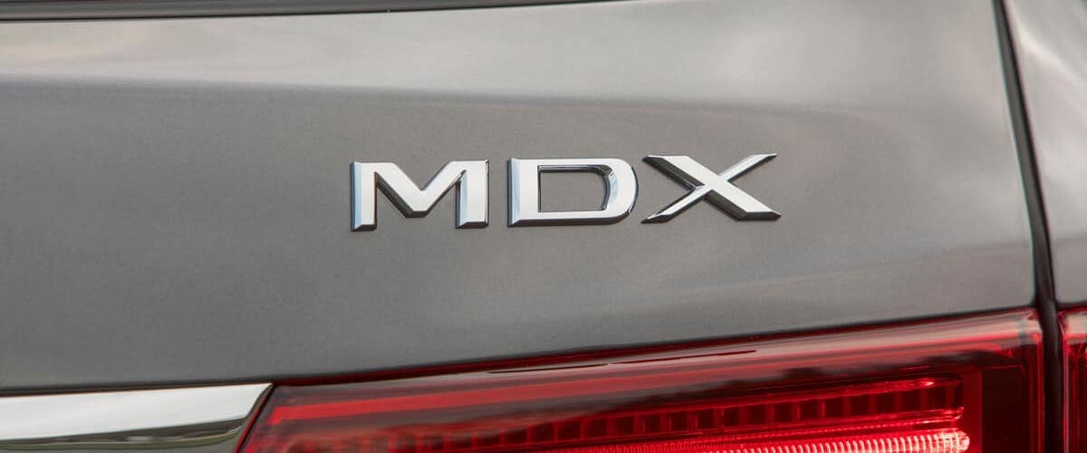 Close on MDX badge of silver 2020 Acura MDX