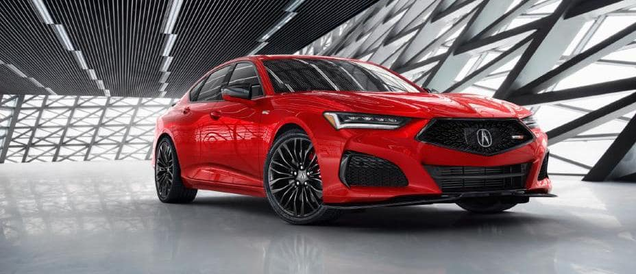Red 2021 Acura TLX preview photo in large well-lit room