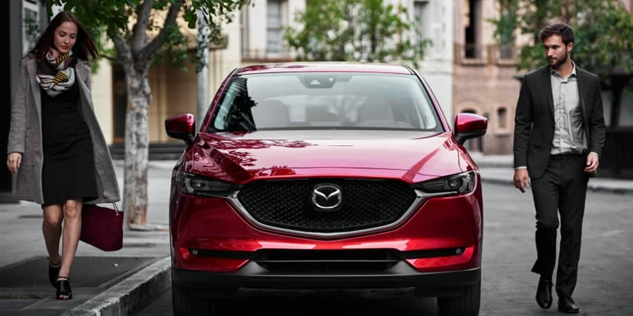 Man and woman walk away from 2018 Mazda CX-5