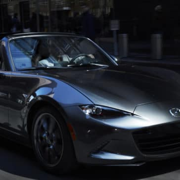man drives 2017 Mazda Miata MX-5 RF