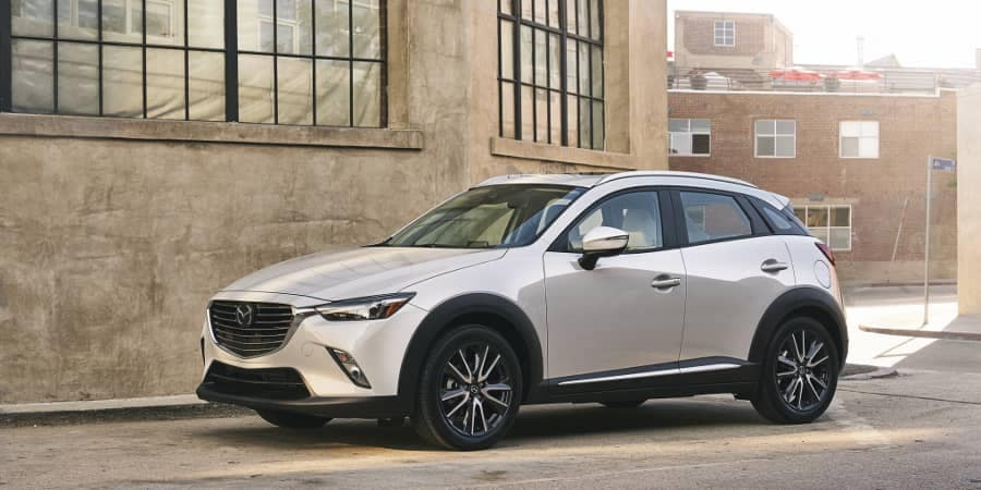 2018 MAZDA CX-3 parked near warehouse