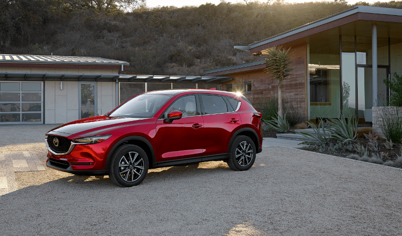 2018 Mazda CX-5 parked in front of house