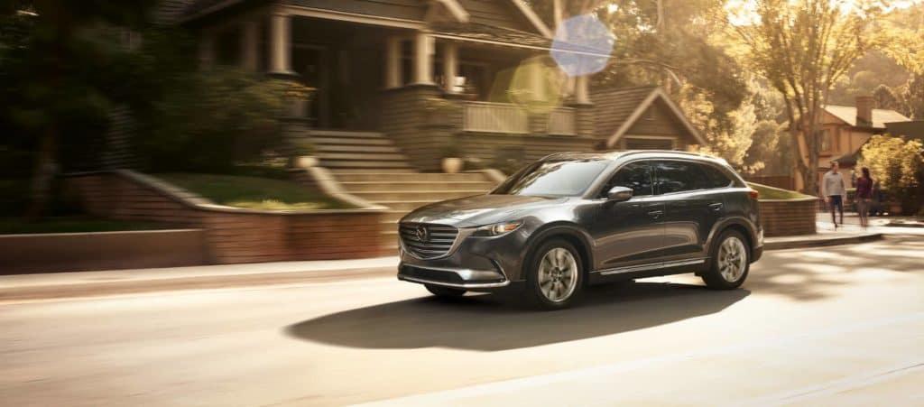 2018 Mazda CX-9 drives past house