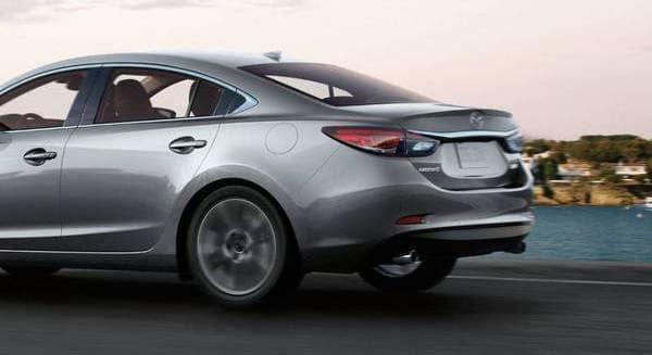 Silver Mazda Driving