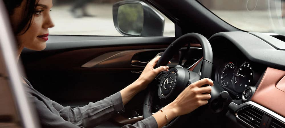 Woman driving a 2019 Mazda CX-9