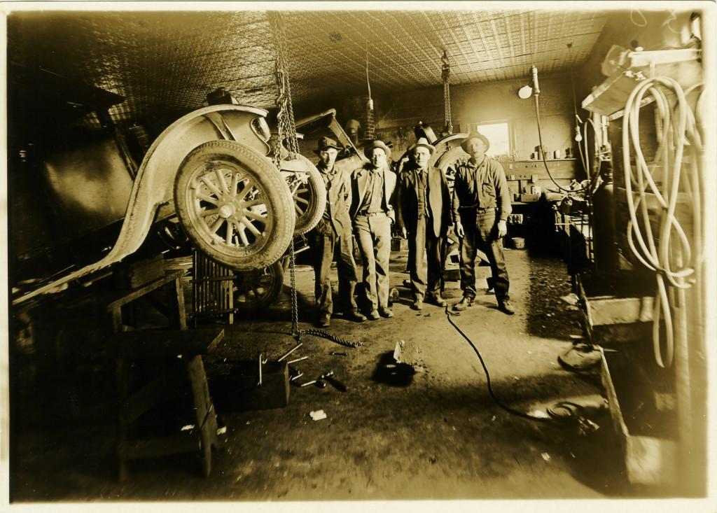 Inside of Shop Area 1928 L to R - Don't know, Oliver Johnson, Joye Johnson, Henry (Hank) Kruger