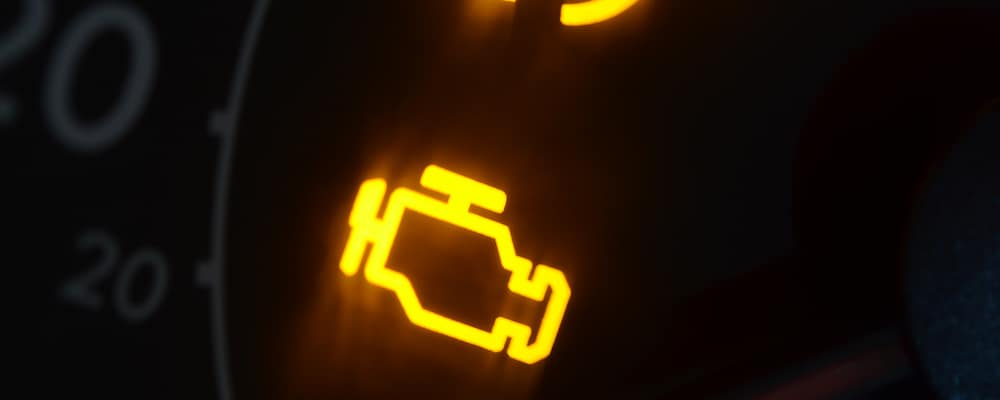 The check engine light on a RAM 1500 glows bright orange on the dashboard.
