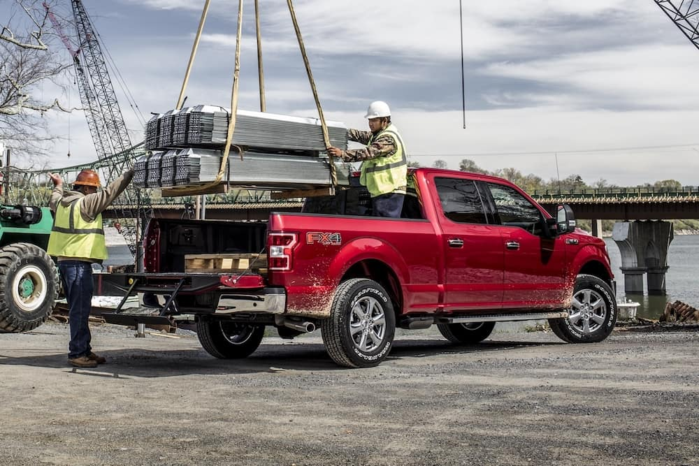 2020 Ford XLT with materials being loaded into the bed