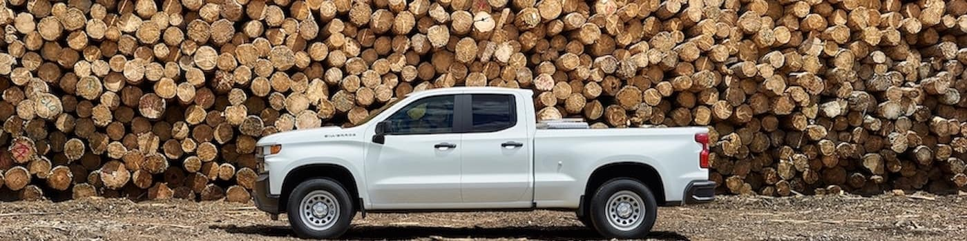 2020 Chevy Silverado parked in front of stacks of wood