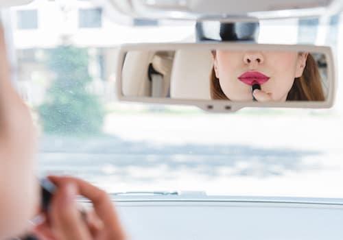 Applying makeup in car
