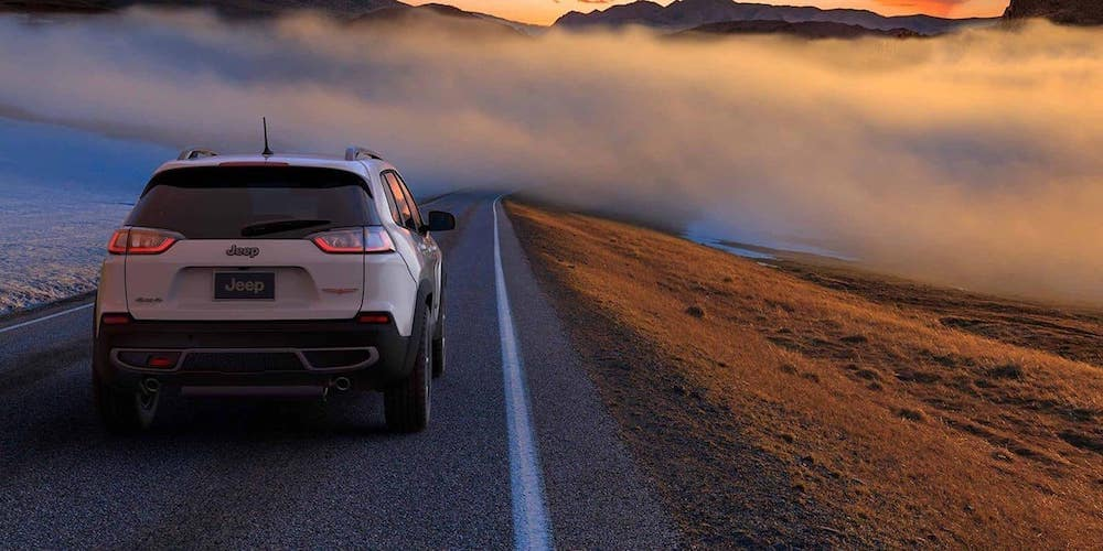 Jeep Cherokee driving on a foggy road