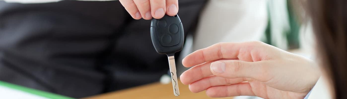 Handing car keys to customer
