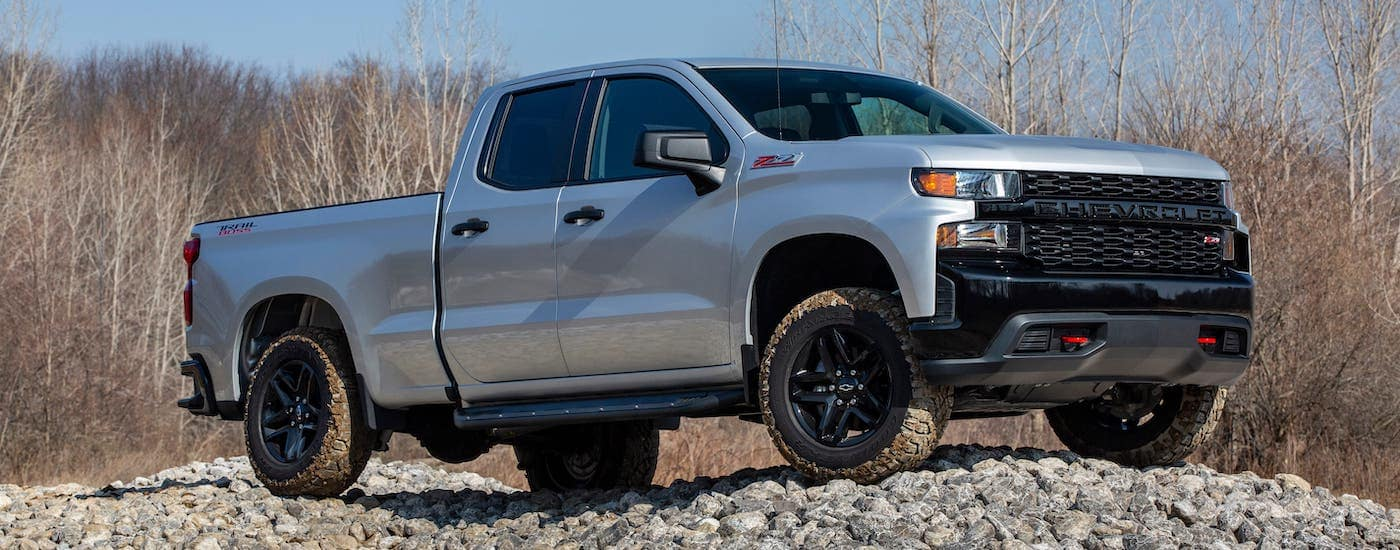 A silver 2021 Chevy Silverado 1500 TrailBoss is parked on a rock pile after leaving a Chevy dealer in VA.
