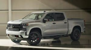 A silver 2021 Chevy Silverado 1500 Redline Edition is parked in the shade of a parking garage after leaving a Hampton Roads Chevy dealership.