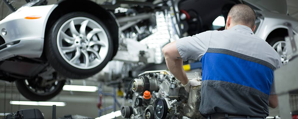 Mechanic working on car on lift