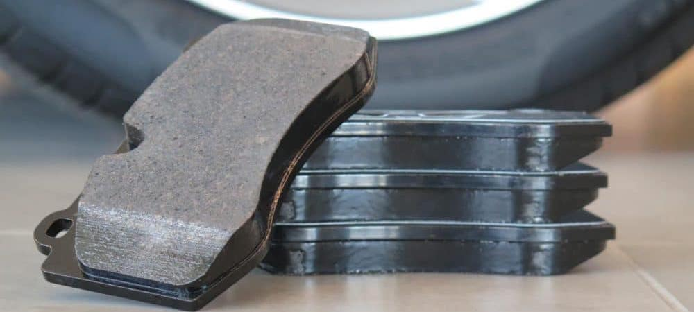 Brake pads stacked near tire