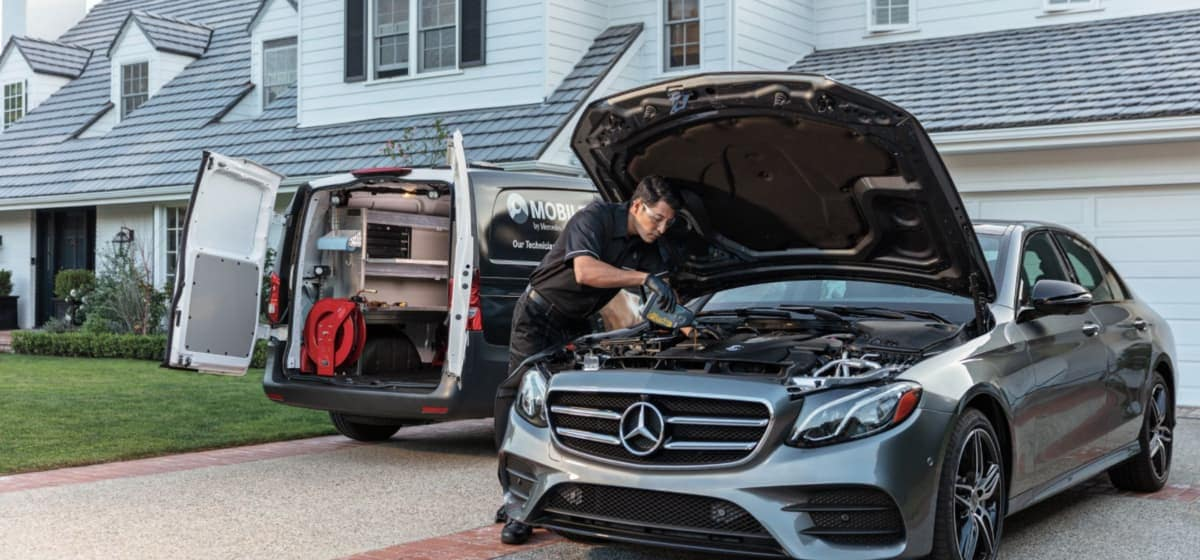Mercedes-Benz mechanic performing service at home