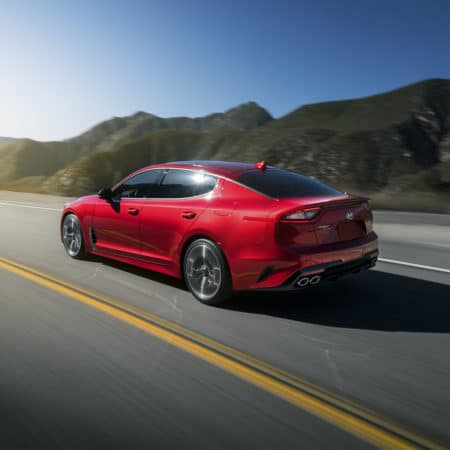 Red 2019 Kia Stinger on Highway