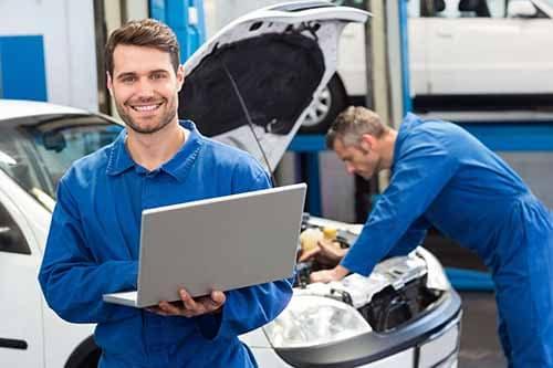 Mechanic Working on Computer