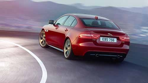 2018 Jaguar XE driving rear view