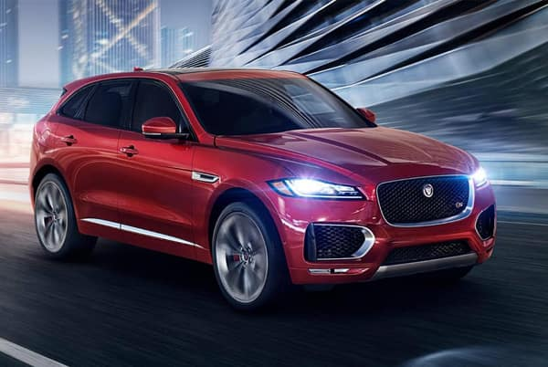 2019 Jaguar F-Pace - Red exterior driving in the city at night
