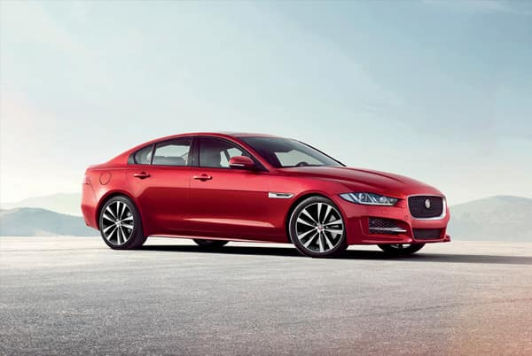 2019 Jaguar XE - Red exterior parked in front of mountains