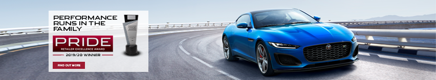 Alt Text: BLUE JAGUAR F-TYPE COUPE DRIVING DOWN WINDING ROAD WITH CLEAR SKIES IN BACKGROUND. PERFORMANCE RUNS IN THE FAMILY. PRIDE RETAILER EXCELLENCE AWARD. 2019-2020 WINNER. FIND OUT MORE.