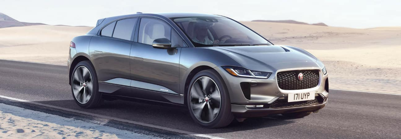 2019 Jaguar I-PACE electric crossover driving down highway