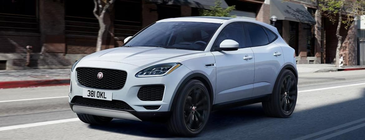 The 2019 Jaguar E-PACE driving down the street.
