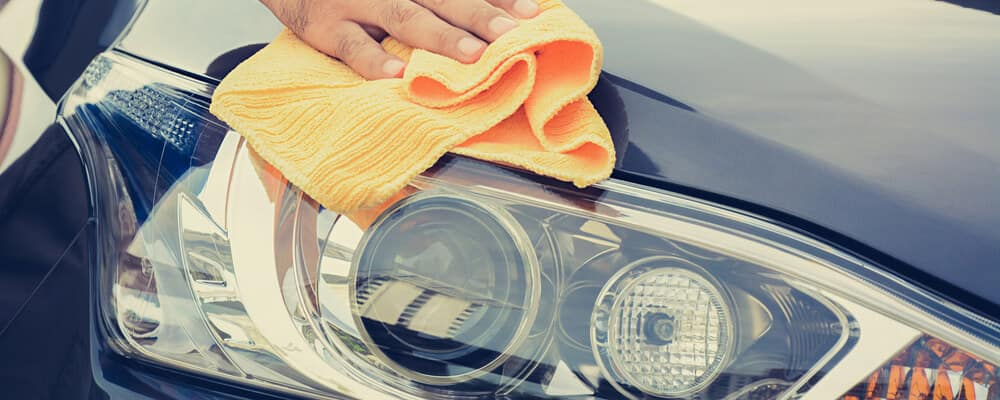 A man cleaning car with microfiber cloth, car detailing