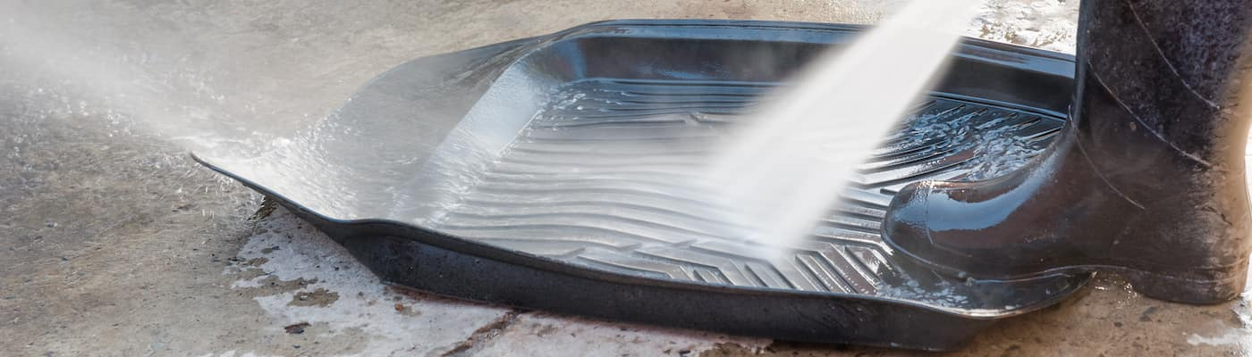 Hosing down a rubber floor mat