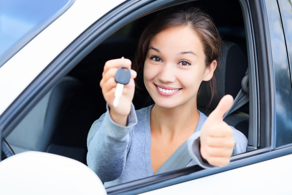 Happy woman with car keys