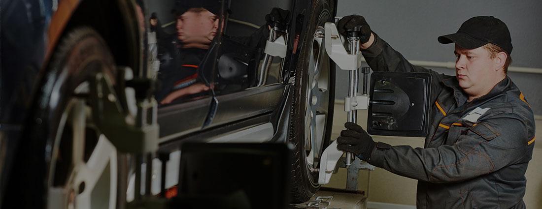 Service technician fixing a tire.