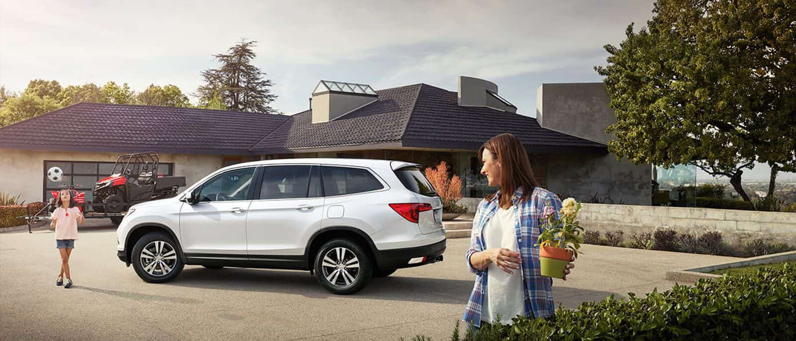 white 2017 Honda Pilot with family
