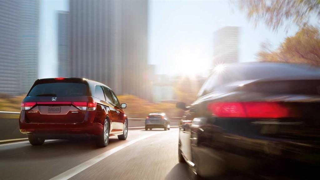 red 2017 Honda Odyssey on road