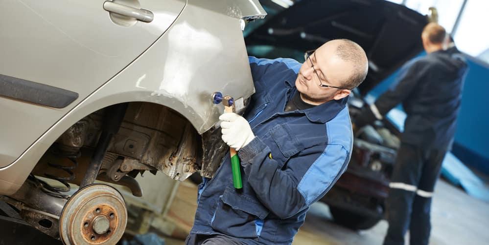 Mechanic fixing cars