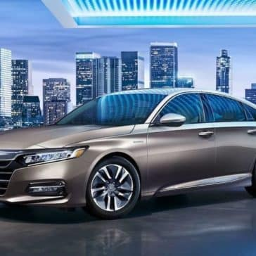 2019 Honda Accord with city skyline in the background