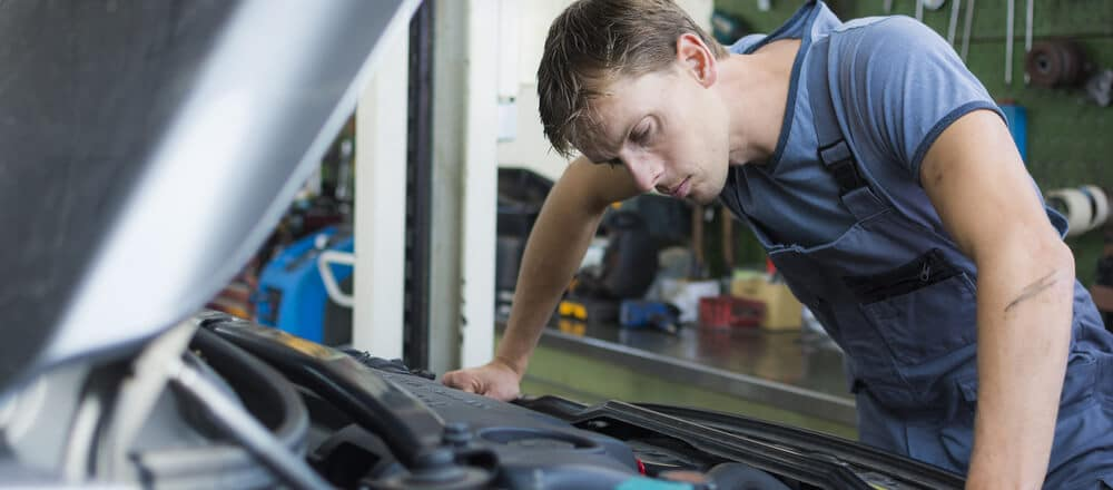 Mechanic checking car