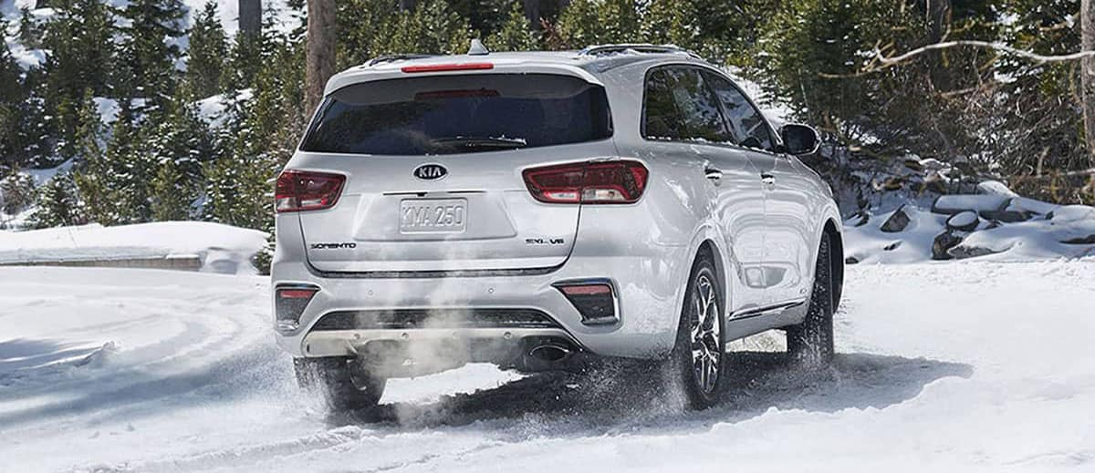 rear exterior of 2018 Kia Sportage in snow