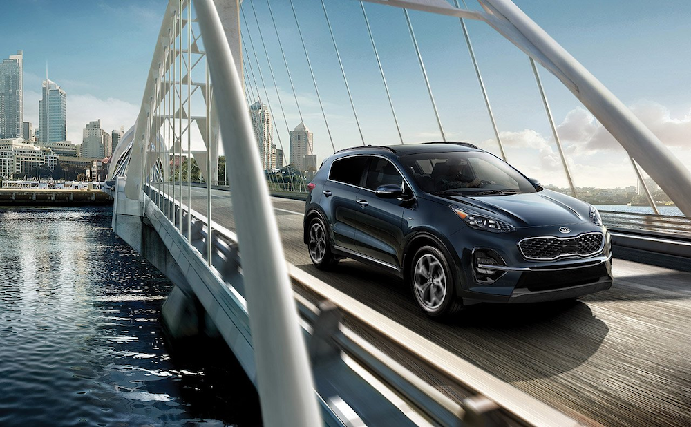 2020 Sportage driving over a bridge